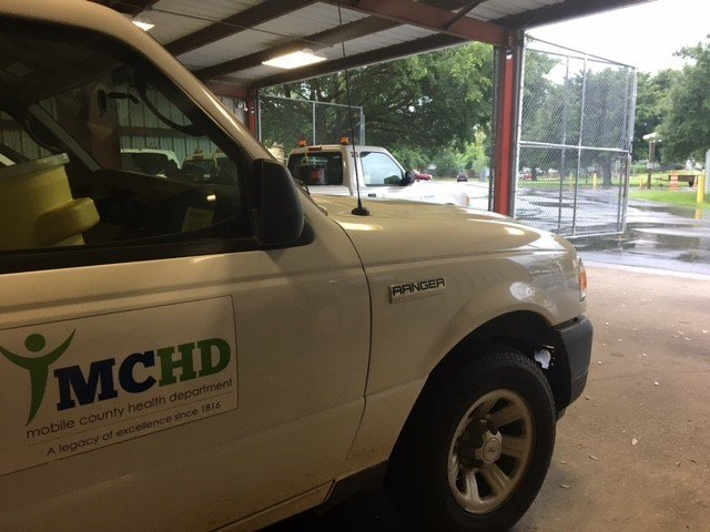A MCHD mosquito spray truck sits inside the garage during a storm. Photo: FOX10 News Reporter Alexa Knowles.