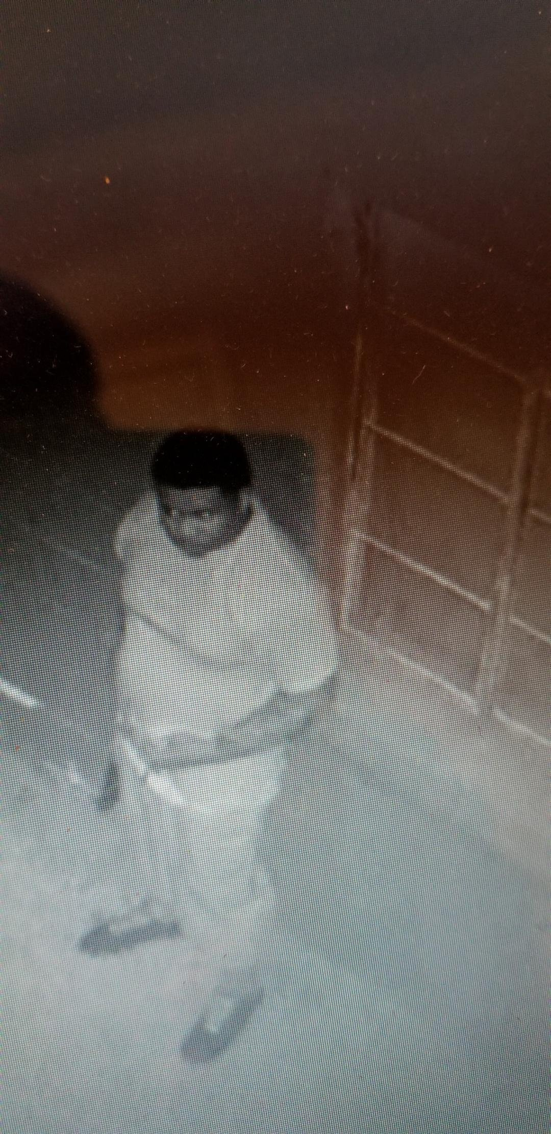This is the crook, caught on surveillance camera, who tried to steal from New Community Church of God in Christ on Sunday night. (Credit: Charles Archie)