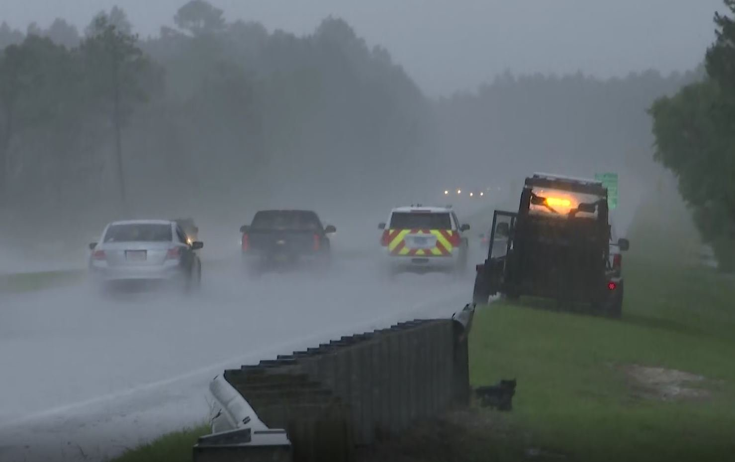Rain falls on Foley Beach Express as officials respond to the site of a small plane crash in woods off the highway. (Photo: Daeshen Smith, FOX10 News)