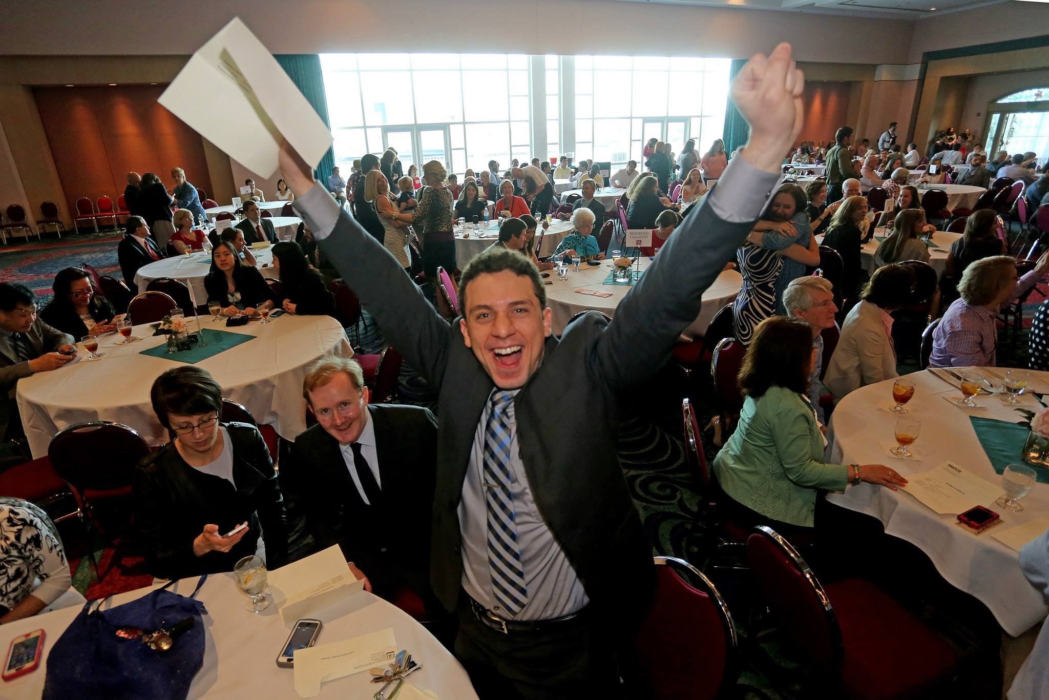 Omar Mazher celebrates after opening his envelope and finding out he matched in psychiatry at Harvard.