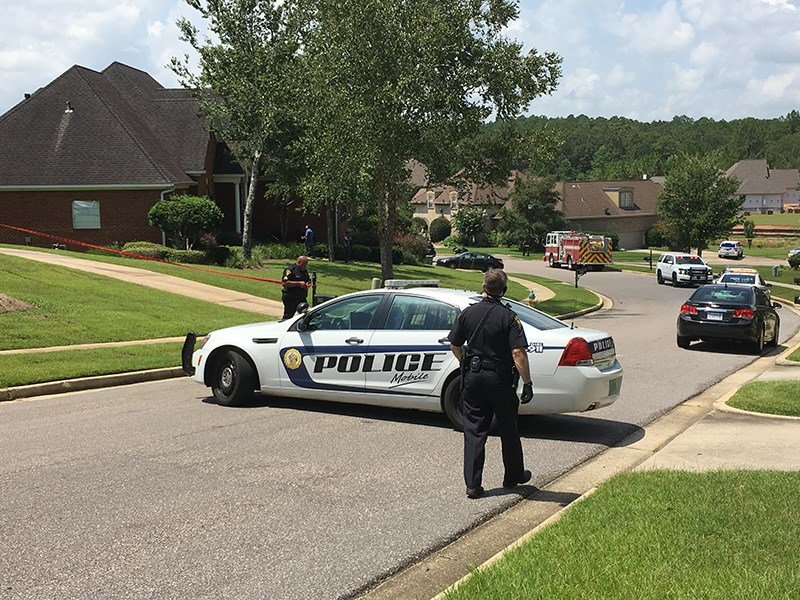 Police on scene at Wynnridge Drive (Photo: Asha Staples, FOX10 News)